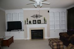Like this but I would put the tv above the mantle I think