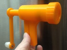 """Semi-useful for shredding or making ribbons out of not-too-hard and not-too-soft foods. (Too soft, and it gets destroyed by cranking action, too hard and it won't cut - this is plastic, not metal). Attach knob using M3 screw and two nuts. Glue either """"xholder"""" or """"spiked holder"""" (only for harder stuff) onto end of crank after inserting thru pusher.  Notch in disc lines up inside retainer ring.  Screw ring onto body, insert pusher into body, apply pressure, and crank away.  Tested with…"""