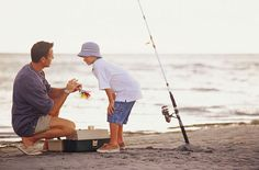Stock Photo : Father teaching son how to fish