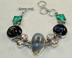 Shell,Pearl, Glass bracelet designed and created by Sizzling Silver. Please visit  www.sizzlingsilver.com. Product code: BR-8234