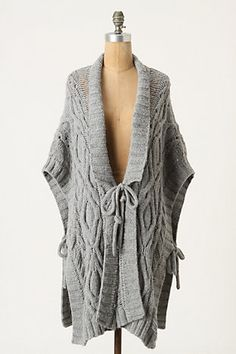 Cable knit poncho/cape does practical double duty ~perfect for wrapping up in the cool Fall air.