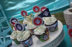 Custom football and soccer themed birthday party cupcake toppers and wrappers - they were a hit! Plus I found some gold award trophy's at the local dollar store!