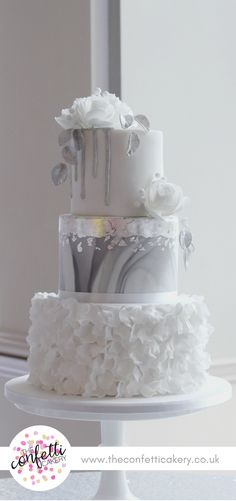 Silver Winter inspired wedding cake, with petal ruffles, marble, silver leaf and sugar flowers. Image & Cake: The Confetti Cakery.