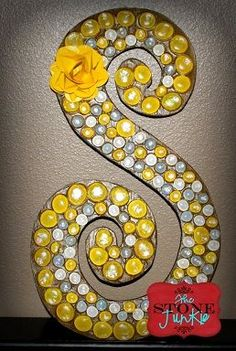 Wood letter w/ flat bottomed marbles.