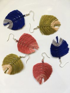 Delicate and very light earrings in settled colourways. Enjoy my handmade earrings and visit my website bydashka.etsy.com #macrameearrings #macrameleaves #macramefeathers #makrameohrringe #makramefeders #makrameblat #handmadeearrings #handgemachteohrringe