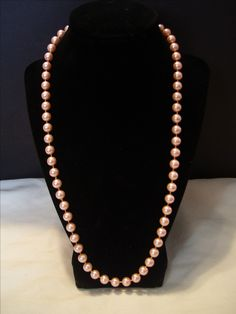"""Very attractive vintage style light pink 18"""" necklace. Beads are 8mm ceramic. Would wear well going to any function or office. All items listed were handmade by me unless otherwise noted. 10% of all sales will be donated to the Alzheimers Association in ..."""