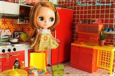 Blythe in a retro kitchen