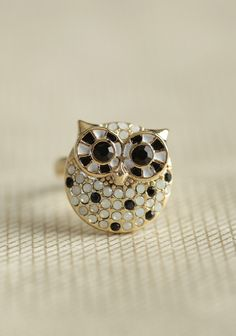 Bejeweled Bird Ring 14.99 from Ruche. This dazzling gold-toned ring features a darling owl adorned with black and white rhinestones.Adjustable0.5