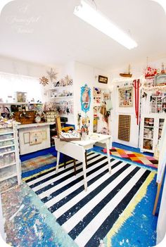 This studio! I love the painted-on rug.