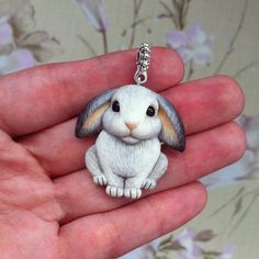Adorable realistic bunny keychain in clay