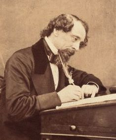 """Dickens working at his desk in 1858, two years before """"Great Expectations"""" was published in """"All The Year Round"""""""