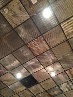 Replace boring ceiling tiles with rusty corrugated metal. From Grimaldi& Replace boring ceiling tiles with rusty corrugated metal. From Grimaldi's in Dallas. Replace boring ceiling tiles with rusty corrugated metal. Corrugated Tin Ceiling, Metal Ceiling Tiles, Corrugated Metal, Corrugated Roofing, Small Deck Ideas On A Budget, Small Deck Designs, Barn Tin, Metal Barn, Metal Roof