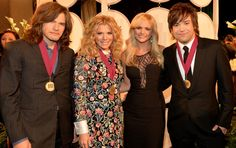 How many country stars can you fit into one photo? The Band Perry's Reid Perry, Kimberly Perry and Neil Perry mingle with Miranda Lambert backstage at the 61st Annual BMI Country Awards on Nov. 5 in Nashville, Tenn.