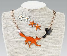 """Enameled Fox & Crow Jewelry:  GaelSong Exclusive! In Aesop's fable, a fox tricks a crow through flattery. The compliments will be sincere when you wear this magnificent hand-crafted fox-and-crow necklace. Irish designer Geraldine Murphy brings her sense of fun and meticulous craft to this jewelry. Each piece is hand-enameled on copper; each will vary slightly, as will the coordinating earrings (specify Orange or White earrings). Copper-link necklace adjusts up to 19"""". Made in Ireland."""