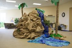 Cool DIY waterfall idea for Shipwrecked VBS! Explore more decoration ideas at Concordia Supply! Waterfall Decoration, Diy Waterfall, Vbs Themes, Ocean Themes, Safari Theme, Jungle Theme, Safari Jeep, Jungle Decorations, Vbs Crafts
