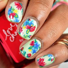 A mint creme nail polish serves as the freshest base for delicate but colorful floral patterns. Check out the video tutorial for the steps, and use this manicure as your inspiration.