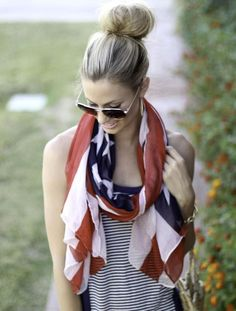 high bun, USA flag as a scarf, and a striped tank. Perfect summertime outfit for a bbq