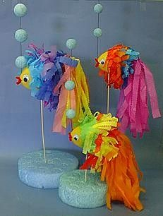 Something Fishy - Three brightly colored tropical fish decorated in tissue paper are a fun summertime or pool party centerpiece. --- Cute idea for a mermaid or under the sea party