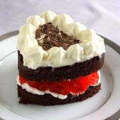Black forest cake is a very moist chocolate cake made with crème fraîche and cocoa powder and layers of kirsch (cherry liqueur), cherry jam, mascarpone, maraschino cherries and chocolate shavings.