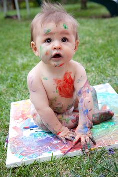 We saw this idea and had to recreate it.  9 month baby painting while sitting on canvas.