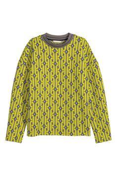 Sweat-shirt jacquard: Sweat-shirt jacquard avec bord-côtes de couleur contrastée à l'encolure. Couture d'épaule descendue et manches longues.