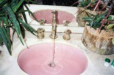 Vintage bathroom countertop - pink sink, marble countertop, brass fixtures