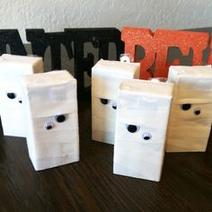 I found this idea on Pinterest, loved it, so made these for the kindergarten class Halloween Party! Used athletic tape, self adhesive google eyes (two sizes),  and juice boxes! Wish I would have covered the fronts with something, the athletic tape is slightly transparent with the dark writing on the cartons.