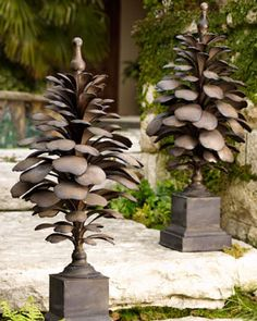 Pine Cone Sculptures ~ I would place these on the fireplace mantle...nice seasonal decoration.