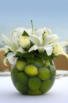 Isn't this fun? Who would have thought to put limes in a vase of flowers? Not me. So creative & it works, I think.