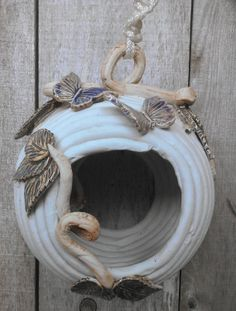 Hey, I found this really awesome Etsy listing at http://www.etsy.com/listing/160375180/hanging-coiled-ceramic-bird-house-or