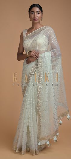 Frost white saree in organza with foil printed buttis all over. Border enhanced with gotta patches and zari work. Fancy Sarees, Party Wear Sarees, Indian Designer Outfits, Designer Dresses, Designer Sarees Wedding, Buy Designer Sarees Online, Buy Sarees Online, Indian Dresses, Indian Outfits