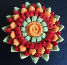 Felt flower brooch, via Flickr.