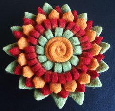 Felt flower brooch, via Flickr.