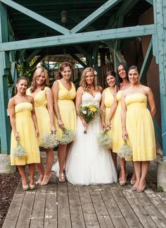soft yellow bridesmaid dresses with babys breath bouquets