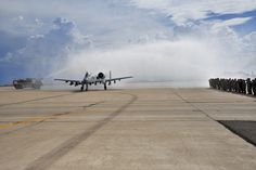 "U.S. Air Force Col. Kevin E. Blanchard, 355th Fighter Wing commander taxis through water streams to celebrate after his ""fini"" flight in an A-10 Thunderbolt II at Davis-Monthan Air Force Base, Ariz., July 30, 2104. A ""fini"" flight is a military aviation tradition that marks the end of a pilot's or commander's time at a location or command. (U.S. Air Force Photo by Airman 1st Class Chris Massey/Released)"