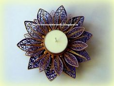 Quilled candle light holder - by: the quiller whose name is written above the candle.