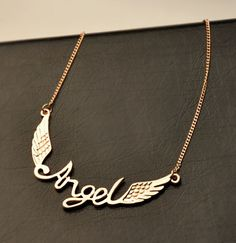Angel Wing Statement Necklace | LilyFair Jewelry  -  could bend wire into word with a jewel or pearl on either side instead of wings