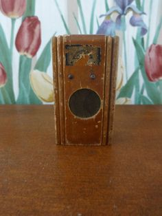 """File under radio antique DOLLHOUSE FURNITURE MINIATURE. Solid wood - 2 knobs intact - Round """"Speaker"""" in center - Top decal missing in some areas. 