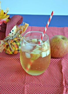 Grab a straw and sip on this sweet and tart Caramel Apple Sangria all fall long! #caramelrecipes #applerecipes #sangriarecipes | Apple Recipes | Caramel Recipes | Sangria Recipes | Wine | Wine Recipes Caramel Apple Recipes | Fall Beverages | Fall Drinks |