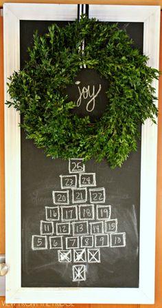 Idea! Create your own advent calendar with a chalkboard and fresh boxwood wreath! Beautiful!