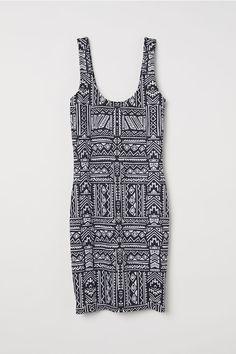 cfc6ad9fcd1bb7 Mouwloze tricot jurk - Zwart wit dessin - DAMES