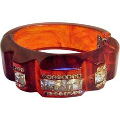 Carved bakelite clamper rhinestones rootbeer swirl from Green Mannequin Exclusively on Ruby Lane
