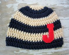 pattern by Skylarnme. I like that the baby hat looks like a varsity sweater with letter and all.