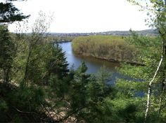 View of the Merrimack River in Concord NH, with the capitol city downtown visible in the distance, Taken from a cliff in back of NH Fish & Game HQ.