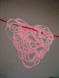 Yarn and glue hearts for Valentine's Day