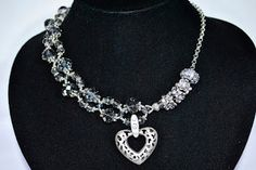 Unique asymmetrical intertwined design made of translucent crystals with a beautiful crystal encrusted heart pendant with chain and crystal encrusted charms. Approximate width around the neck 48 cm length with pendant Charms, Snow, Crystals, Pendant, Heart, Unique, Beautiful, Collection, Jewelry