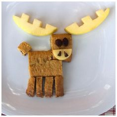 A cereal bar, apples and raisins are all you need for this crazy cute food plate.