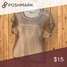 Bohemian Mesh Top Tan mesh top perfect for Coachella times ! Also a great cover up top over swim suits . Used ONCE . Basically new , the back side is not pictured, it is all just mesh , no embroidery around the back except for the floral detail around the neckline, if you have any questions please ask!☺️💕🔺♥️BUNDLE FOR 20% OFF!‼️🔻 Tops Blouses