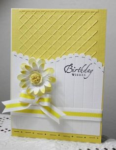 bright yellow and white card with embossing, a dimensional daisy and  bow...