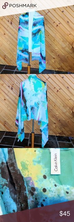 """🎨 Calvin Klein Silk Multicolored Wrap or Scarf Beautiful CK silk wrap/stole/scarf in a splattered paint design.  Very gently used - I have only worn it twice on special occasions.  Stunning with a black dress or outfit.  CK tag and button detail in pictures.  Measures 27.5"""" x 72"""". Calvin Klein Accessories Scarves & Wraps"""